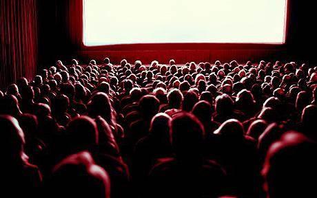 """Žmonės laukia lietuviško kino premjerų ir gausiai plūsta į sales. Nuotr. autorius Getty (""""The Telegraph"""")"""